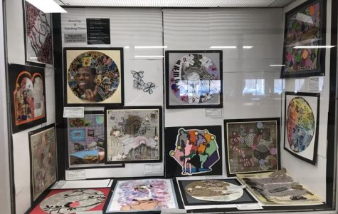 A display of collages from Mrs. Roman's Drawing and Painting classes. Students were given base paper and any other supplies they desired and given free reign to create a collage. Photo courtesy of Becky Wood