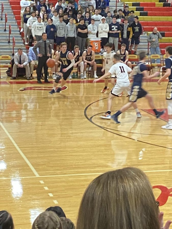 Kyle Haegele accelerates at the top of the court to begin a counterattack for the Roxbury offense.