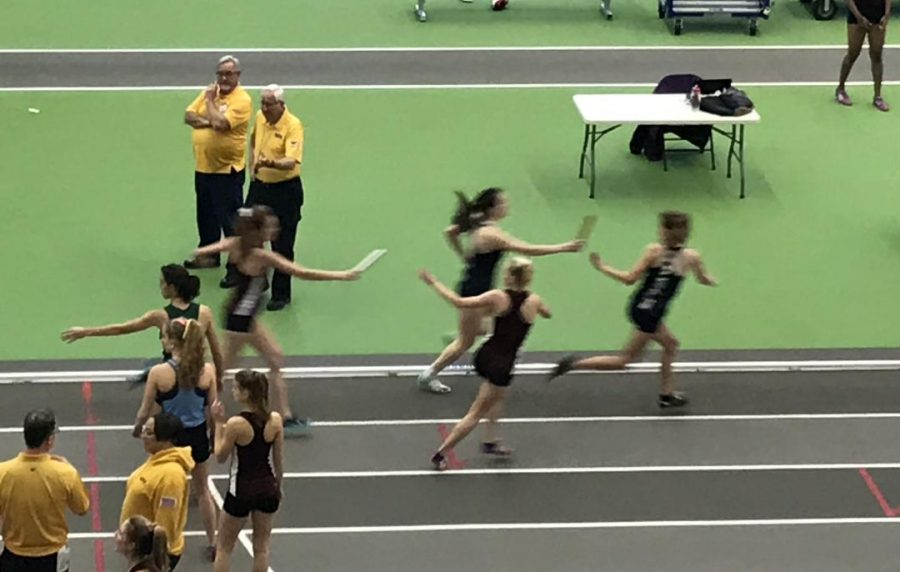 Sophomore Lauren McGowan passes the baton to Senior Captain Lauren Tom as they proudly represent the Gaels in the Women's 4x400m at Morris County Championships.