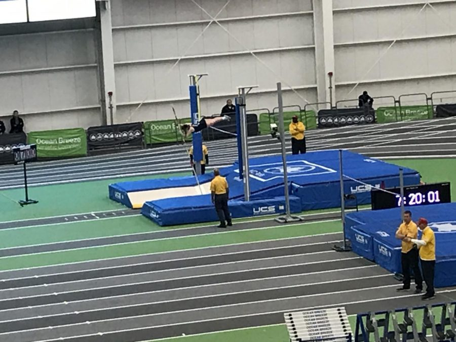 Sophomore Alexis Merola pole vaults at Morris County Championships, the meet where she broke the Roxbury High School Indoor Track record with 9 feet and 7 inches.