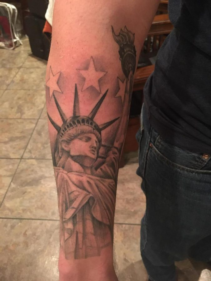 Ryan Wood, cousin of RHS juniors Rebecca and Erin Wood's patriotic tattoo. Ryan Wood is a member of the US Army, this tattoo is an example of how common tattoos are in the military. Photo Courtesy of Jessica Wood.
