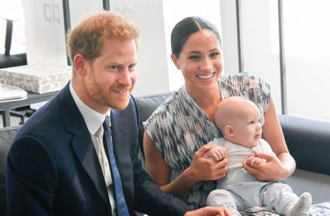 Harry Windsor-Mountbatton and Meghan Markle sitting without their son, Archie. Photo Courtesy of Goodtoknow.com